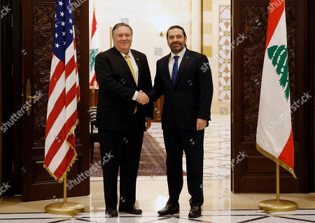 Saad Hariri, Mike Pompeo. Lebanese Prime Minister Saad Hariri, shakes hands with U.S. Secretary of State Mike Pompeo, left, in Beirut, Lebanon,. Pompeo arrived in Lebanon on Friday amid strong regional condemnation of U.S. President Donald Trump's declaration about U.S. recognition of Israel's sovereignty over the Israeli-occupied Golan Heights