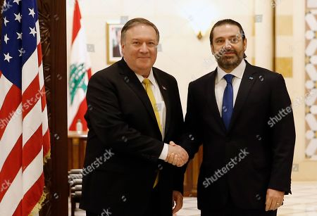 Saad Hariri, Mike Pompeo. Lebanese Prime Minister Saad Hariri, right, shakes hands with U.S. Secretary of State Mike Pompeo, left, in Beirut, Lebanon,. Pompeo arrived in Lebanon on Friday amid strong regional condemnation of President Donald Trump's declaration that it's time the U.S. recognized Israel's sovereignty over the Israeli-occupied Golan Heights