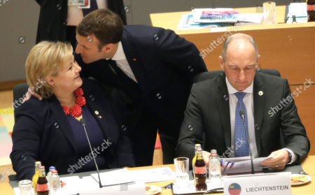 (L-R) Norway's Prime Minister Erna Solberg, French President Emmanuel Macron, and Liechtenstein Prime Minister Adrian Hasler during a round table at the European Council Summit in Brussels, Belgium, 22 March 2019. European Union leaders on 21 March agreed to extend Brexit until 22 May 2019 if British MPs will approve Brexit agreement next week. If British Prime Minister May will lose the vote on Brexit deal for the third time, the delay will be until 12 April.