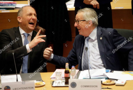 Stock Picture of European Commission President Jean-Claude Juncker (R) speaks with Leichtenstein's Prime Minister Adrian Hasler (L) during a round table at the European Council Summit in Brussels, Belgium, 22 March 2019. European Union leaders on 21 March agreed to extend Brexit until 22 May 2019 if British MPs will approve Brexit agreement next week. If British Prime Minister May will lose the vote on Brexit deal for the third time, the delay will be until 12 April.