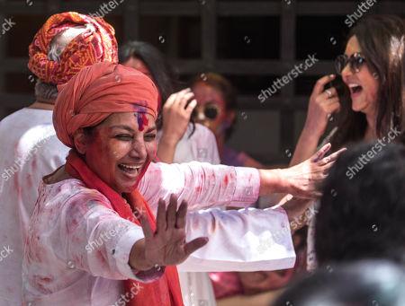 Bollywood actor Shabana Azmi and lyricist Javed Akhtar participate in a celebration of Holi Festival