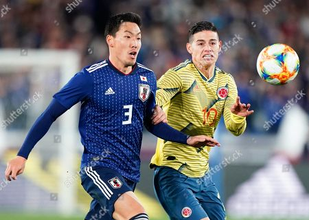 Japan's defender Gen Shoji (L) in action against Colombia's midfielder James Rodriguez (R) during the Kirin Challenge Cup friendly soccer match between Japan and Colombia in Yokohama, Japan, 22 March 2019.