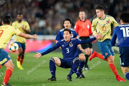 Japan's defender Gen Shoji (C) in action against Colombia's midfielder James Rodriguez (R) during the Kirin Challenge Cup friendly soccer match between Japan and Colombia in Yokohama, Japan, 22 March 2019.