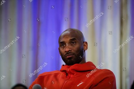 Stock Image of Former Los Angeles Lakers NBA basketball player Kobe Bryant listens to a question as he meets with students at Andrew Hamilton School in Philadelphia, . Kobe Bryant was promoting the book The Wizenard Series: Training Camp he created with writer Wesley King