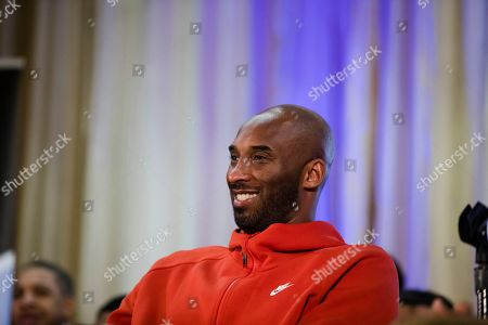 Stock Picture of Former Los Angeles Lakers NBA basketball player Kobe Bryant listens to a question as he meets with students at Andrew Hamilton School in Philadelphia, . Kobe Bryant was promoting the book The Wizenard Series: Training Camp he created with writer Wesley King