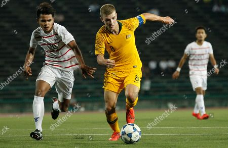 Cambodia's Tes Sambath (L) in action against Riley McGree (C) of Australia during the AFC U-23 Championship Thailand 2020 qualifiers match between Cambodia and Australia, in Phnom Penh, Cambodia, 22 March 2019.