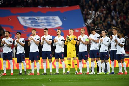 The England team honor the late Gordon Banks at the beginning of the UEFA EURO 2020 qualifier soccer match between England and Czech Republic in London, Britain, 22 March 2019.