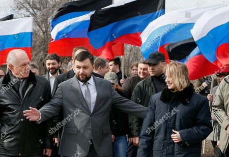 Natalia Poklonskaya (R), member of Russian parliament and former Crimean Prosecutor Chief and Denis Pushilin (L), the head of the self-proclaimed Donetsk People's Republic (DNR) take part in unveiling ceremony of commemorative plate dedicated to 5th anniversary of Russian Spring and annexation of Crimea in the separatist-held Makeevka city in Donetsk area, Ukraine, 22 March 2019.