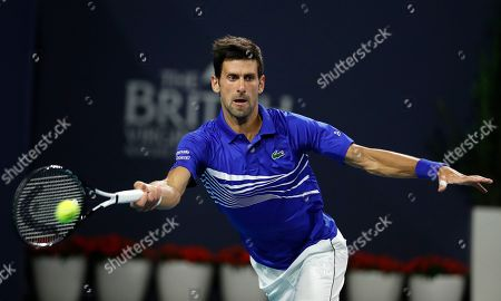 Novak Djokovic of Serbia in action against Bernard Tomic of Australia during their men's singles match at the Miami Open tennis tournament in Miami, Florida, USA, 22 March 2019.