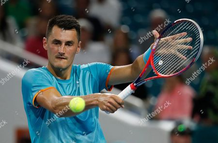 Bernard Tomic of Australia in action against Novak Djokovic of Serbia during their men's singles match at the Miami Open tennis tournament in Miami, Florida, USA, 22 March 2019.