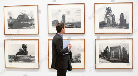 """A member of the media observes photogravures """"From the series Reconstrucitons,"""" by the Pakistani-American artist Huma Bhabha, at the Institute of Contemporary Art Boston in Boston, Massachusetts, USA 22 March 2019. The exhibition 'Huma Bhabha: They Live,' spans over 20 years of Bhabha's work in sculpture, drawing and photography, and will be on display through 27 May 2019."""