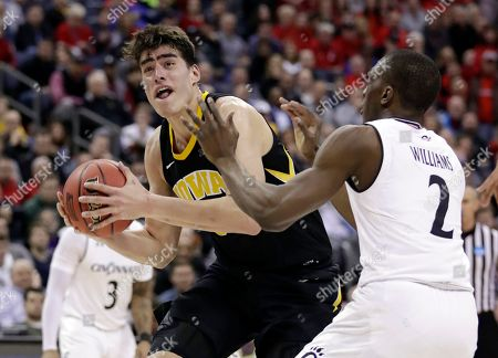 Keith Williams, Luka Garza. Iowa's Luka Garza (55) drives past Cincinnati's Keith Williams (2) in the second half during a first round men's college basketball game in the NCAA Tournament in Columbus, Ohio