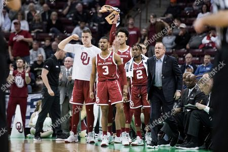 Oklahoma head coach Lon Kruger, right, and his players react after a score against Mississippi during a first round men's college basketball game in the NCAA Tournament, in Columbia, S.C. Oklahoma defeated Mississippi 95-72