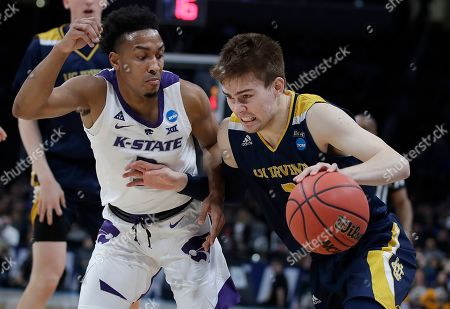 Robert Cartwright, Kamau Stokes. UC Irvine guard Robert Cartwright, right, drives against Kansas State guard Kamau Stokes during the first half of a first round men's college basketball game in the NCAA Tournament, in San Jose, Calif