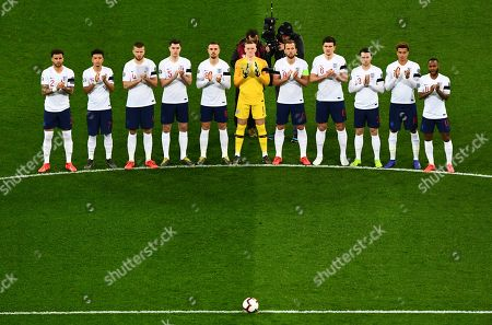 Stock Photo of England players stand for a minutes' applause for Gordon Banks