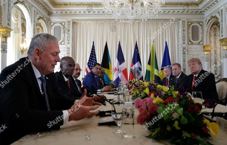 President Donald Trump, right, meets with Caribbean leaders at Mar-A Lago, in Palm Beach, Fla. From left are Saint Lucia's Prime Minister Allen Michael Chastanet, Haiti President Jovenel Moise,Dominican Republic President Danilo Medina, Jamaica Prime Minister Andrew Holness and Bahama Prime Minister Hubert Minnis