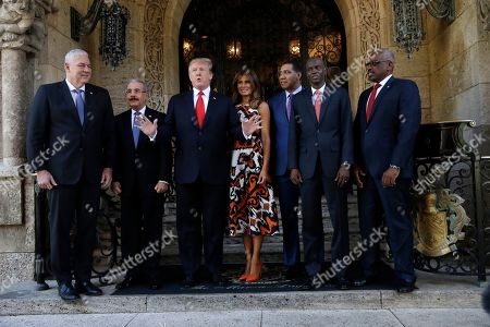 President Donald Trump and first lady Melania Trump meet with Caribbean leaders at Mar-A Lago, in Palm Beach, Fla. From left are Saint Lucia's Prime Minister Allen Michael Chastanet, Dominican Republic President Danilo Medina, President Trump, Melania Trump, Jamaica's Prime Minister Andrew Holness, Haiti President Jovenel Moise and Bahama Prime Minister Hubert Minnis