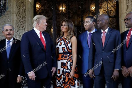 President Donald Trump and first lady Melania Trump meet with Caribbean leaders at Mar-A Lago, in Palm Beach, Fla. From left are Dominican Republic President Danilo Medina, President Trump, Melania Trump, Jamaica's Prime Minister Andrew Holness, Haiti President Jovenel Moise and Bahama Prime Minister Hubert Minnis