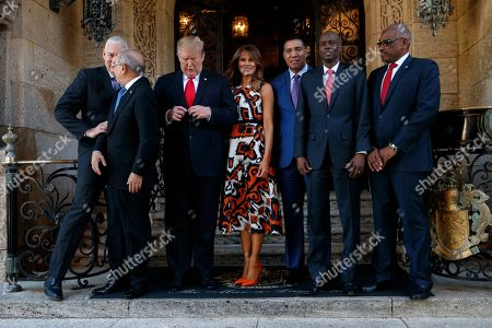 Donald Trump, Melania Trump, Allen Michael Chastanet, Danilo Medina, Andrew Holness, Jovenel Moise, Hubert Minnis. President Donald Trump and first lady Melania Trump pose for media with Caribbean leaders at Mar-A Lago, in Palm Beach, Fla. From left are Saint Lucia's Prime Minister Allen Michael Chastanet, Dominican Republic President Danilo Medina, President Trump, Melania Trump, Jamaica's Prime Minister Andrew Holness, Haiti President Jovenel Moise and Bahama Prime Minister Hubert Minnis