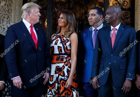 Donald Trump, Melania Trump, Andrew Holness, Jovenel Moise. President Donald Trump and first lady Melania Trump pose for media with Caribbean leaders at Mar-A Lago, in Palm Beach, Fla. From left are President Trump, Melania Trump, Jamaica's Prime Minister Andrew Holness, and Haiti President Jovenel Moise