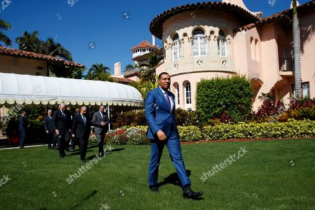Caribbean leaders, lead by Jamaica's Prime Minister Andrew Holness, walk to talk to media after meeting with President Donald Trump at Mar-A Lago, in Palm Beach, Fla