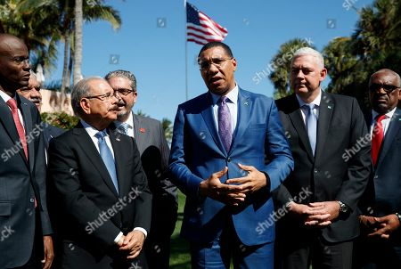 Hubert Minnis, Andrew Holness, Allen Michael Chastanet, Jovenel Moise. Caribbean leaders, from left, Haiti President Jovenel Moise, Dominican Republic President Danilo Medina, Jamaica's Prime Minister Andrew Holness, Saint Lucia's Prime Minister Allen Michael Chastanet and Bahama Prime Minister Hubert Minnis, talk to media after meeting with President Donald Trump at Mar-A Lago, in Palm Beach, Fla