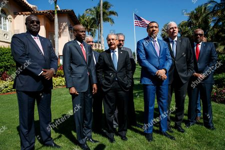 Hubert Minnis, Andrew Holness, Allen Michael Chastanet, Jovenel Moise, Bocchit Edmond. Caribbean leaders, from left, Haiti Foreign Minister Bocchit Edmond, Haiti President Jovenel Moise, Dominican Republic President Danilo Medina, Jamaica's Prime Minister Andrew Holness, Saint Lucia's Prime Minister Allen Michael Chastanet and Bahama Prime Minister Hubert Minnis, talk to media after meeting with President Donald Trump at Mar-A Lago, in Palm Beach, Fla