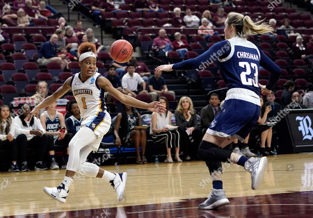 Marquette's Danielle King (1) reaches for a pass as Rice's Alexah Chrisman (23) defends during the first half of a first round women's college basketball game in the NCAA Tournament, in College Station, Texas