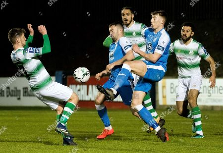 Stock Image of Finn Harps vs Shamrock Rovers. Finn Harps' Nathan Boyle and Sam Todd with Dylan Watts of Shamrock Rovers