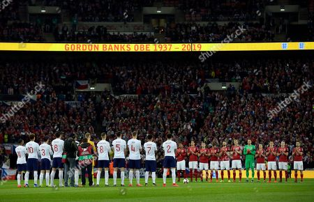 England, left, and Czech Republic players observe a minute of silence to mark the death of former England goalkeeper Gordon Banks prior to the start of the Euro 2020 group A qualifying soccer match between England and the Czech Republic at Wembley stadium in London