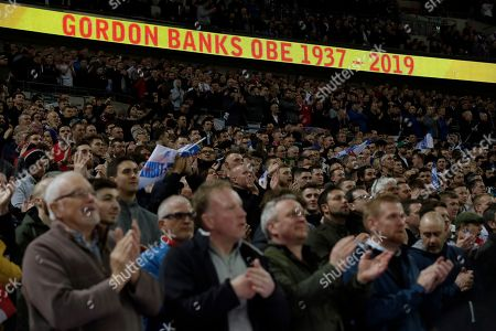 Fans observe a minute of silence to mark the death of former England goalkeeper Gordon Banks prior to the start of the Euro 2020 group A qualifying soccer match between England and the Czech Republic at Wembley stadium in London