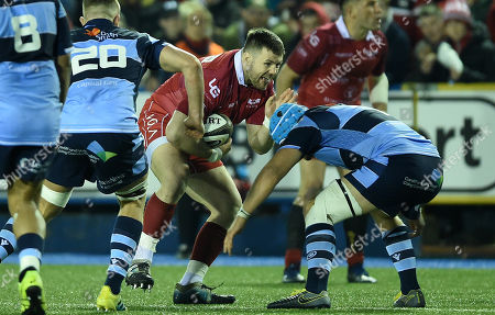 Rob Evans of Scarlets takes on Olly Robinson of Cardiff Blues.