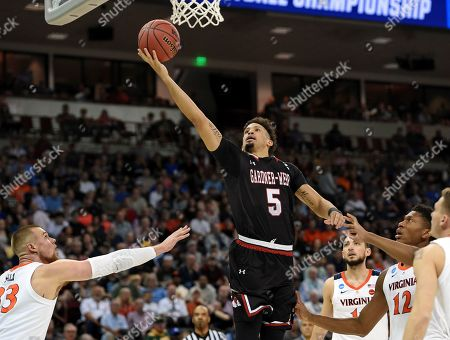 Gardner-Webb's Jose Perez (5) drives to the basket past Virginia's Jack Salt (33) during a first-round game in the NCAA men's college basketball tournament in Columbia, S.C