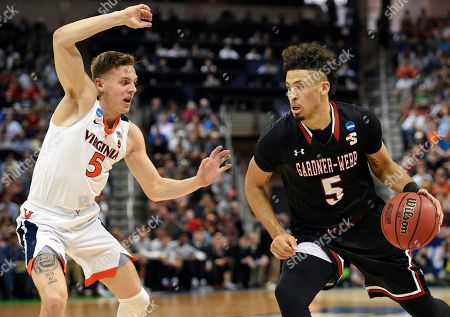 Gardner-Webb's Jose Perez (5) drives against Virginia's Kyle Guy during a first-round game in the NCAA men's college basketball tournament in Columbia, S.C