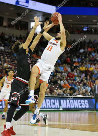 Virginia's Ty Jerome (11) shoots over Gardner-Webb's Jose Perez (5) during a first-round game in the NCAA men's college basketball tournament in Columbia, S.C