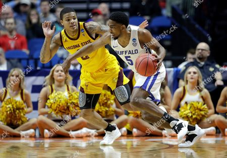 Buffalo's CJ Massinburg (5) drives under pressure from Arizona's Brandon Williams (2) during the first half of a first round men's college basketball game in the NCAA Tournament, in Tulsa, Okla