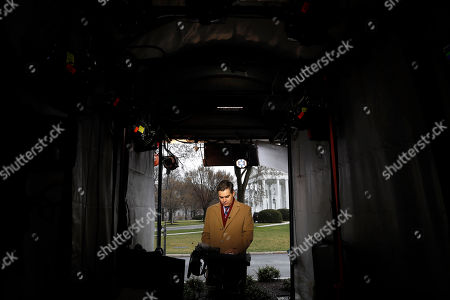 CNN's Jim Acosta waits to make a report with the White House in the background, in Washington, as news breaks that the special counsel Robert Mueller has concluded his investigation into Russian election interference and possible coordination with associates of President Donald Trump. The Justice Department says Mueller delivered his final report Friday to Attorney General William Barr, who is reviewing it. Mueller's report, still confidential, sets the stage for big public fights to come. The next steps are up to Trump's attorney general, to Congress and, in all likelihood, federal courts