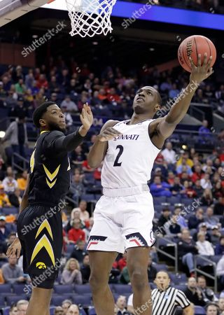 Cincinnati's Keith Williams (2) drives to the basket against Iowa's Isaiah Moss (4) in the first half during a first round men's college basketball game in the NCAA Tournament in Columbus, Ohio
