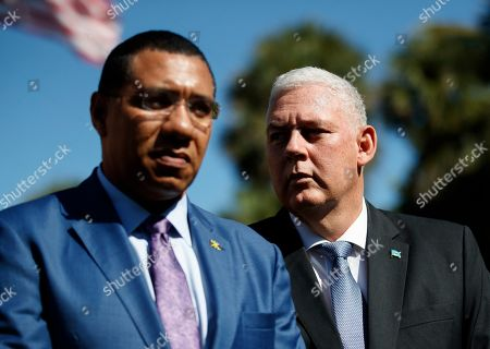 Caribbean leaders Jamaica's Prime Minister Andrew Holness, left, and Saint Lucia's Prime Minister Allen Michael Chastanet gather to talk to media after meeting with President Donald Trump at Mar-A Lago, in Palm Beach, Fla