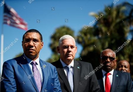 Caribbean leaders, from left, Jamaica's Prime Minister Andrew Holness, Saint Lucia's Prime Minister Allen Michael Chastanet and Bahama Prime Minister Hubert Minnis, gather to talk to media after meeting with President Donald Trump at Mar-A Lago, in Palm Beach, Fla