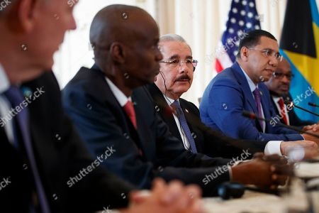 President Donald Trump meets with Caribbean leaders at Mar-A Lago, in Palm Beach, Fla. From left, Saint Lucia's Prime Minister Allen Michael Chastanet, Haiti President Jovenel Moise, Dominican Republic President Danilo Medina, Jamaica's Prime Minister Andrew Holness, Bahama Prime Minister Hubert Minnis