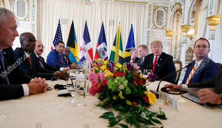 President Donald Trump meets with Caribbean leaders at Mar-A Lago, in Palm Beach, Fla. From left, Saint Lucia's Prime Minister Allen Michael Chastanet, Haiti President Jovenel Moise, Dominican Republic President Danilo Medina, Jamaica's Prime Minister Andrew Holness, Bahama Prime Minister Hubert Minnis, National Security Adviser John Bolton, Acting Defense Secretary Patrick Shanahan, President Donald Trump and acting White House chief of staff Mick Mulvaney