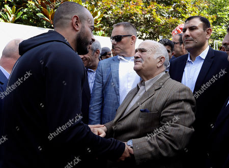 His Royal Highness Prince El Hassan bin Talal Hashemite, second right, of the Kingdom of Jordan greets a worshipper outside the Al Noor mosque in Christchurch, New Zealand, . The mosque reopened today following the March 15 mass shooting