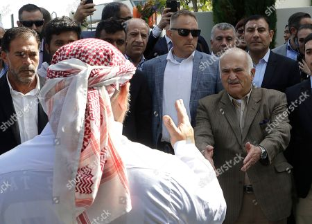 His Royal Highness Prince El Hassan bin Talal Hashemite, second right, of Jordan, greets a worshipper who had just performed a haka outside the Al Noor mosque in Christchurch, New Zealand, . The mosque reopened today following the March 15 mass shooting