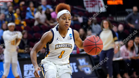 Marquette's Danielle King brings the ball up the court against Rice during the first half of a first round women's college basketball game in the NCAA Tournament, in College Station, Texas
