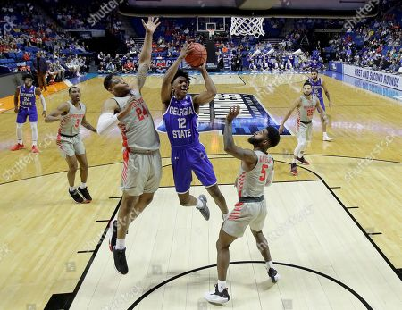 Georgia State's Kane Williams (12) shoots under pressure from Houston's Breaon Brady (24) and Corey Davis Jr. (5) during the first half of a first round men's college basketball game in the NCAA Tournament, in Tulsa, Okla