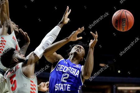 Houston's Corey Davis Jr. (5) knocks the ball away from Georgia State's Kane Williams (12) during the second half of a first round men's college basketball game in the NCAA Tournament, in Tulsa, Okla