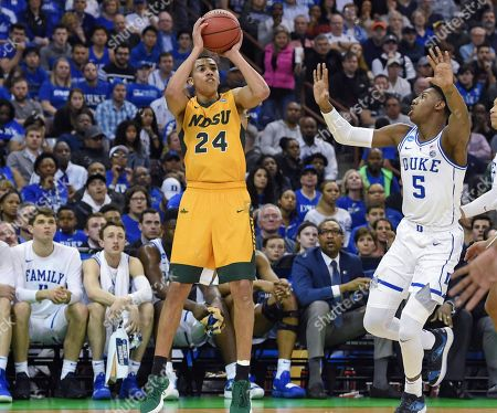 North Dakota State's Tyson Ward (24) shoots a 3-pointer while defended by Duke's RJ Barrett (5) during the first half of a first-round game in the NCAA men's college basketball tournament in Columbia, S.C