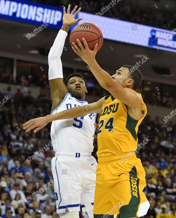 Stock Picture of North Dakota State's Tyson Ward (24) drives to the basket while defended by Duke's RJ Barrett (5) during the first half of a first-round game in the NCAA men's college basketball tournament, in Columbia, S.C