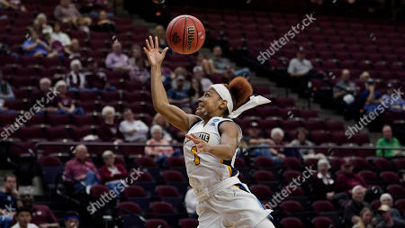 Marquette's Danielle King reaches for a pass against Rice during the first half of a first round women's college basketball game in the NCAA Tournament, in College Station, Texas